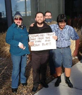 From left: Darcy Shepard Kennedy (Vice President), Antonio Gonzalez (Treasurer), Jeremy Allistair, and Joko Cailles (Communications Officer) at the Reno Women's March on January 21, 2017.